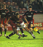Photo: Dave Linney.<br />Walsall v Lincoln City. Coca Cola League 2. 16/02/2007.<br />Walsall's Martin Butler (C) in the thick of the action.