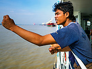 20 NOVEMBER 2017 - YANGON, MYANMAR: A passenger on the Dala Ferry. Tens of thousands of commuters ride the ferry every day. It brings workers into Yangon from Dala, a working class community across the river from Yangon. A bridge is being built across the river, downstream from the ferry to make it easier for commuters to get into the city.     PHOTO BY JACK KURTZ