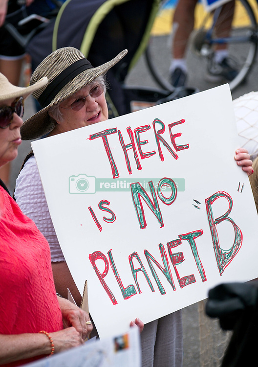 April 29, 2017 - Charleston, SC, United States of America - A protester holds a sign opposing opposing climate change during the People's Climate Parade in solidarity with similar marches around the nation April 29, 2017 in Charleston, South Carolina. The march coincides with the 100th day in office of President Donald Trump and demands action to protect the environment and stop climate change. (Credit Image: © Richard Ellis/Planet Pix via ZUMA Wire)