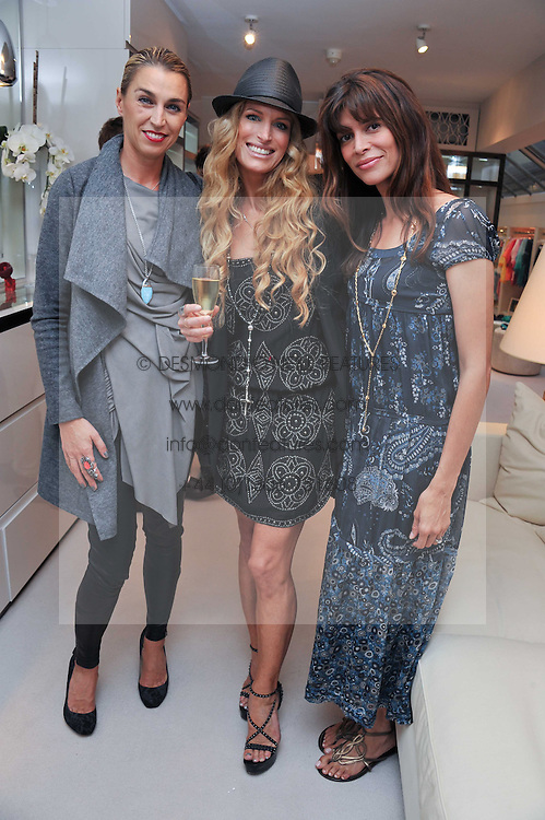 Left to right, ASSIA WEBSTER, LAURA COMFORT and LISA BILTON at the opening of the new Melissa Odabash store in Walton Street, London SW3 on 7th July 2011.
