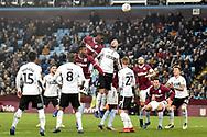 Aston Villa striker Keinan Davis (17)  heads the ball  at goal during the The FA Cup 3rd round match between Aston Villa and Swansea City at Villa Park, Birmingham, England on 5 January 2019.