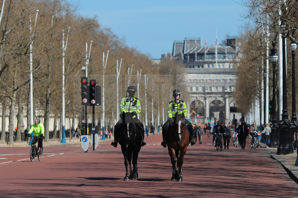 © Licensed to London News Pictures. 17/04/2021. London, UK. Mounted police officers patrol The Mall on the day of the funeral of The Duke of Edinburgh Prince Philip, Queen Elizabeth II's late husband. The funeral will take place in private at Windsor Castle. Photo credit: Rob Pinney/LNP