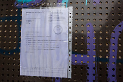London, UK. 23 September, 2015. A High Court order taped outside the property of Mostafa Aliverdipour on the Sweets Way housing estate. A group of housing activists calling for better social housing provision in London occupied properties on the 142-home estate in Whetstone in order to try to prevent the eviction of Mr Aliverdipour, the estate's last-surviving resident, and the planned demolition and redevelopment of the entire estate by Barnet Council and Annington Property Ltd.