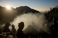 Hikers watch the sun rise while on their way to the top of Mt. Fansipan, Lao Cai Province, Vietnam, Southeast Asia