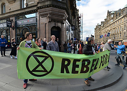 Climate change protesters blocked roads in the city centre including North Bridge, causing severe traffic disruption.<br /> <br /> © Dave Johnston / EEm