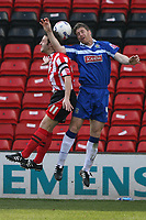 Photo: Pete Lorence.<br />Lincoln City v Stockport County. Coca Cola League 2. 07/04/2007.<br />Scott Kerr and Tony Dinning battle for the ball.