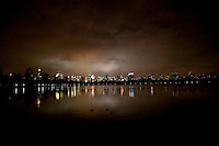 The New York City skyline reflected in the Jacqueline Kennedy Onassis Reservoir in Central Park. April 16, 2009. (Photo by Robert Caplin)