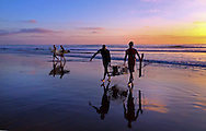 Two lifeguards pulling lobster traps from ocean at Sunet at Del Mar State Beach in Del Mar, California, USA, North America<br /> <br /> THIS IMAGE ALSO AVAILABLE AS SIGNED, LIMITED EDITION PRINT. SERIES LIMITED TO 10.