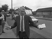 Austin Currie Canvas In Palmerstown (T1)..1989..07.06.1979..06.07.1989..7th June 1989..In the general election The Fine Gael Party chose Mr Austin Currie to contest for a seat in Dail Eireann. Well known as a civil rights activist and peace campaigner Mr Currie hoped to win a seat alongside running mate Mr Jim Mitchell.Mr Currie previously held a seat in the Northern Ireland Executive and held a position as Minister for Housing and Local Planning. Mr Currie is a founder member of the S.D.L.P...Image shows Mr Currie arriving in Palmerstown to begin his canvas for support in the General Election.