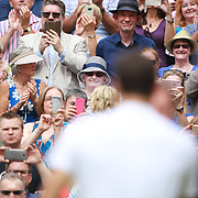LONDON, ENGLAND - JULY 16: Roger Federer of Switzerland celebrates victory with the trophy as spectators look on after the Gentlemen's Singles final of the Wimbledon Lawn Tennis Championships at the All England Lawn Tennis and Croquet Club at Wimbledon on July 16, 2017 in London, England. (Photo by Tim Clayton/Corbis via Getty Images)