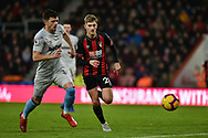 West Ham United Defender, Aaron Cresswell (3) and AFC Bournemouth Midfielder, David Brooks (20) chase the ball during the Premier League match between Bournemouth and West Ham United at the Vitality Stadium, Bournemouth, England on 19 January 2019.