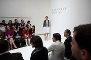 Girl model starts her catwalk at British couture designer Margaret Howell's Autumn fashion show in her design studio