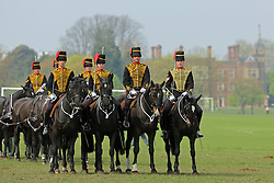 © Licensed to London News Pictures. 24/04/2015.  The King's Troop Royal Horse Artillery were joined by the Royal Artillery Band today for a Musical Drive rehearsal in preparation for their annual inspection next week. The rehearsal took place in Charlton Park, south east London, close to the barracks of the King's Troop RHA in Woolwich. Local landmark Charlton House seen in the background. Credit : Rob Powell/LNP