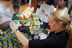 May 23, 2019 - Minneapolis, Minnesota, USA - Julie Trautman from Kowalski's catering set out Amy cookies for Thursday night's office opening party at Klobuchar's new Minnesota presidential campaign headquarters.  It is in the Banks Building, Suite 125 — 615 NE 1st Avenue, Minneapolis.      ] GLEN STUBBE • glen.stubbe@startribune.com   Thursday, May 23, 2019     ..Klobuchar opens presidential campaign HQ in Mpls. (Credit Image: © Glen Stubbe/Minneapolis Star Tribune via ZUMA Wire)