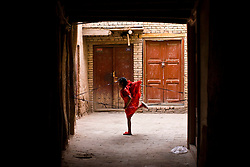 A girl plays in old city in Kashgar, China.