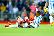 James Milner of Liverpool and Rajiv van La Parra of Huddersfield Town get  tangled up. Premier League match, Liverpool v Huddersfield Town at the Anfield stadium in Liverpool, Merseyside on Saturday 28th October 2017.<br /> pic by Chris Stading, Andrew Orchard sports photography.