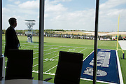"""Frisco ISD Superintendent Dr. Jeremy Lyon looks out over the Cowboys practice fields from a conference room in the new Dallas Cowboys headquarters in Frisco, Texas on August 23, 2016. """"CREDIT: Cooper Neill for The Wall Street Journal""""<br /> TX HS Football sponsorships"""
