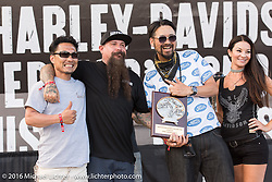 Yuichi Yoshizawa and Yoshikazu Ueda of Custom Works Zon in Japan receiving an award from Jeff Holt for their custom Street 750 at the Harley-Davidson Editors Choice Custom Bike Show during the annual Sturgis Black Hills Motorcycle Rally.  SD, USA.  August 9, 2016.  Photography ©2016 Michael Lichter.