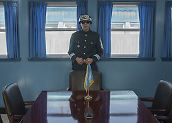 October 14, 2017 - Panmunjom, South Korea - A South Korean soldier stands guard inside the Joint Security Area conference room in the border village of Panmunjom between South and North Korea at the Demilitarized Zone (DMZ) in Panmunjom, South Korea. North Korea renewed its threats to launch ballistic missiles around the U.S. Territory of Guam. (Credit Image: © Yichuan Cao/NurPhoto via ZUMA Press)