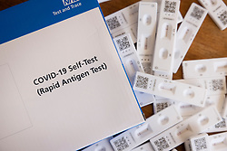 © Licensed to London News Pictures. 08/06/2021. London, UK. Test strips showing a negative result from government supplied rapid Covid-19 lateral flow home testing kits. Parents are being encouraged to use rapid home testing kits for pupils in areas where there are Covid-19 outbreaks in schools. Photo credit: Peter Macdiarmid/LNP