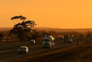 Road traffic at sunset, Regional Victoria.<br /> <br /> For larger JPEGs and TIFF versions contact EFFECTIVE WORKING IMAGE via our contact page at : www.photography4business.com