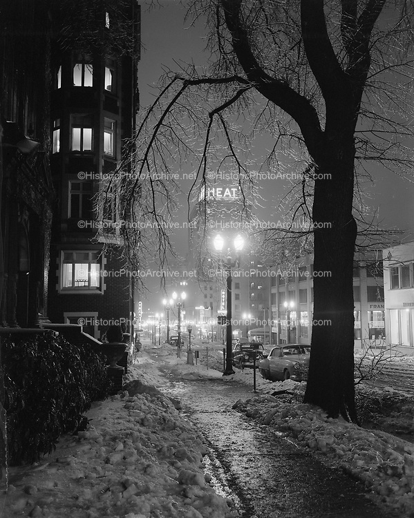 Y-500119-01.  Night view of SW 6th looking north from Madison in the snow. January 19, 1950. Published on cover of Portland Gas & Coke Co. 1949 Annual Report.