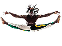 one Brazilian black man dancer dancing capoeira on white background