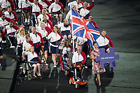 20160907 Copyright onEdition 2016©<br /> Free for editorial use image, please credit: onEdition<br /> <br /> Flag Bearer Lee Pearson leads out the ParalympicsGB athletes for the opening ceremony of the 2016 Paralympic Games taking place in Rio De Janeiro.<br /> <br /> ParalympicsGB is the name for the Great Britain and Northern Ireland Paralympic Team that competes at the summer and winter Paralympic Games. The Team is selected and managed by the British Paralympic Association, in conjunction with the national governing bodies, and is made up of the best sportsmen and women who compete in the 22 summer and 4 winter sports on the Paralympic Programme.<br /> <br /> For additional Images please visit: http://www.w-w-i.com/paralympicsgb_2016/<br /> <br /> For more information please contact the press office via press@paralympics.org.uk or on +44 (0) 7717 587 055<br /> <br /> If you require a higher resolution image or you have any other onEdition photographic enquiries, please contact onEdition on 0845 900 2 900 or email info@onEdition.com<br /> This image is copyright onEdition 2016©.<br /> <br /> This image has been supplied by onEdition and must be credited onEdition. The author is asserting his full Moral rights in relation to the publication of this image. Rights for onward transmission of any image or file is not granted or implied. Changing or deleting Copyright information is illegal as specified in the Copyright, Design and Patents Act 1988. If you are in any way unsure of your right to publish this image please contact onEdition on 0845 900 2 900 or email info@onEdition.com