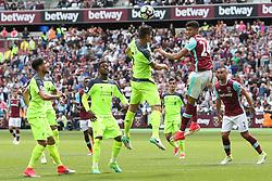 14 May 2017 - Premier League Football - West Ham United v Liverpool - Dejan Lovren of Liverpool and Ashley Fletcher of West Ham battle for a header - Photo: Charlotte Wilson