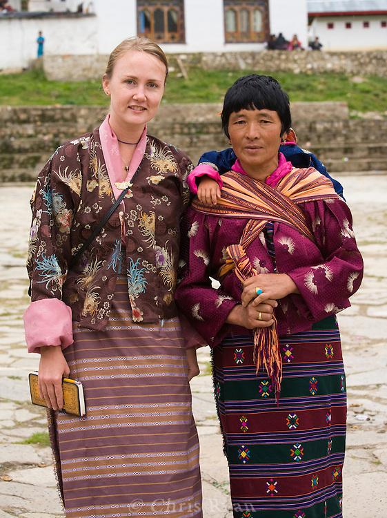 Traveler and Bhutanese woman, Haa Tsechu (festival), Haa Valley, Bhutan