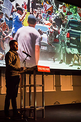 April 13, 2018 - Amsterdam, Netherlands - RYAN KELLY talks about his image, ''Car Attack'' during a presentation at the World Press Photo Festival on Friday, April 13, 2018, in Amsterdam, The Netherlands. Kelly took second prize for Spot News singles for his image taken during the Unite the Right rally in Charlottesville, Virginia. (Credit Image: © Tracy Barbutes via ZUMA Wire)