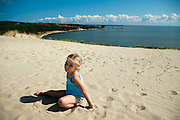 Little girl plays in the sand, Nida, Lithuania; MR on file