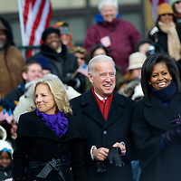 Vice President- elect Joe Biden, wife Jill, and Michele Obama listen to President-elect Obama during their pre-inauguration rally in Wilmington, Delaware, where a crowd of thousands braved sub-zero temperatures to lend their support.  Obama and Biden along with their families traveled by train on a Whistle Stop Tour, opening Inauguration celebrations with rallies in Philadelphia, Wilmington, and Baltimore before their final arrival in Washington, D.C.  The inauguration takes place on January 20, 2009, swearing Obama in as the 44th President of the United States of America.¬?