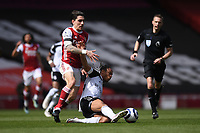 Football - 2020 /2021 Premier League - Arsenal v Fulham - Emirate Stadium<br /> <br /> Arsenal's Hector Bellerin is tackled by Fulham's Bobby De Cordova-Reid.<br /> <br /> COLORSPORT