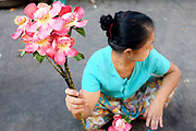 Flowers used for Buddhist offerings for sale at Hledan morning market on 19th March 2016 in Yangon, Myanmar. Hledan is one of the 39 stations on the Yangon Circular Railway