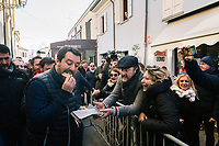 CESENATICO, ITALY - 5 JANUARY 2020: Matteo Salvini, former Interior Minister of Italy and leader of the far-right League party, eats bread and sardines (in reference to the grass-roots movement protesting him) that was offered to him by a supporter as he walks towards the stage of his rally in Cesenatico, Italy, on January 5th 2020.<br /> <br /> Matteo Salvini is campaigning in the region of Emilia Romagna to support the League candidate Lucia Borgonzoni running for governor.<br /> <br /> After being ousted from government in September 2019, Matteo Salvini has made it a priority to campaign in all the Italian regions undergoing regional elections to demonstrate that, in power or not, he still commands considerable support.<br /> <br /> The January 26th regional elections in Emilia Romagna, traditionally the home of the Italian left, has been targeted by Matteo Salvini as a catalyst for bringing down the government. A loss for the center-left Democratic Party (PD) against Mr Salvini's right would strip the centre-left party of control of its symbolic heartland, and probably trigger a crisis in its coalition with the Five Star Movement.