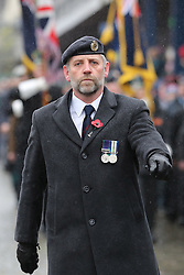 A veteran marches at a Remembrance Sunday service in Fort William town centre, held in tribute for members of the armed forces who have died in major conflicts.