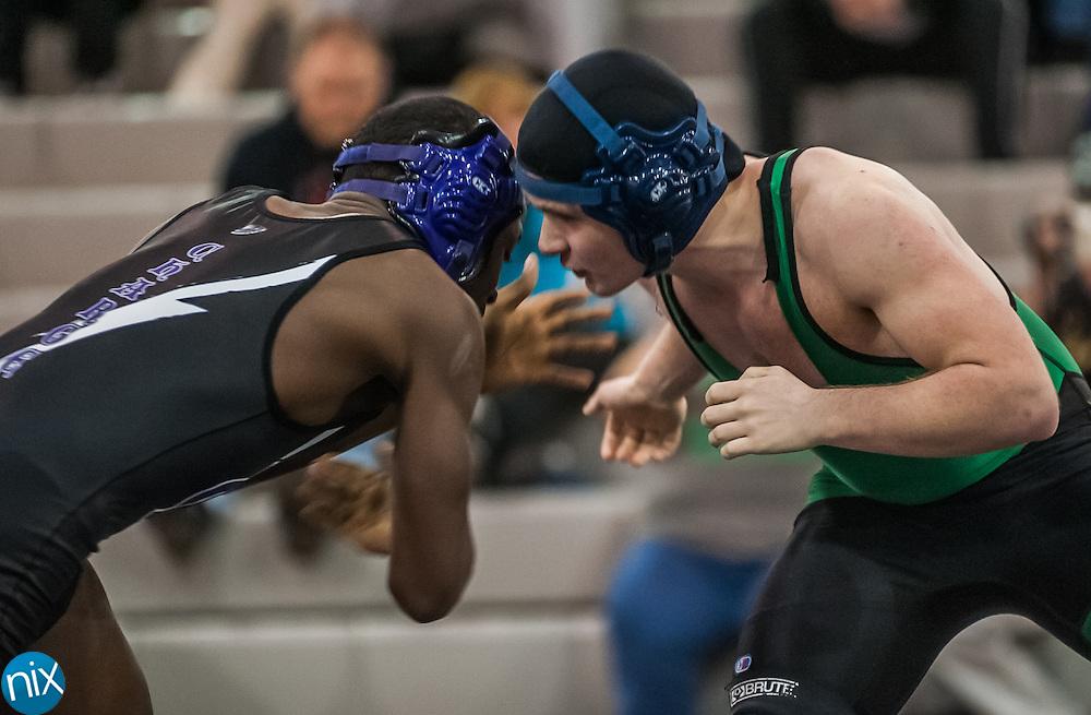 Cox Mill's Dayvuone Pharr wrestles A.L. Brown's Tyler Davis Monday night at Cox Mill High School.