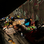 MYTILENE, GREECE - SEPTEMBER 10: Displaced asylum-seekers try to find new shelter in an underpass a few kilometers away from the Moria migrant camp as fires, which started Tuesday night, continue to rage into Thursday inside of the camp on September 10, 2020 in Mytilene, Greece. According to UNHCR, current numbers say the asylum-seekers displaced from the encampment are around 12,000. (Photo by Byron Smith/Getty Images)