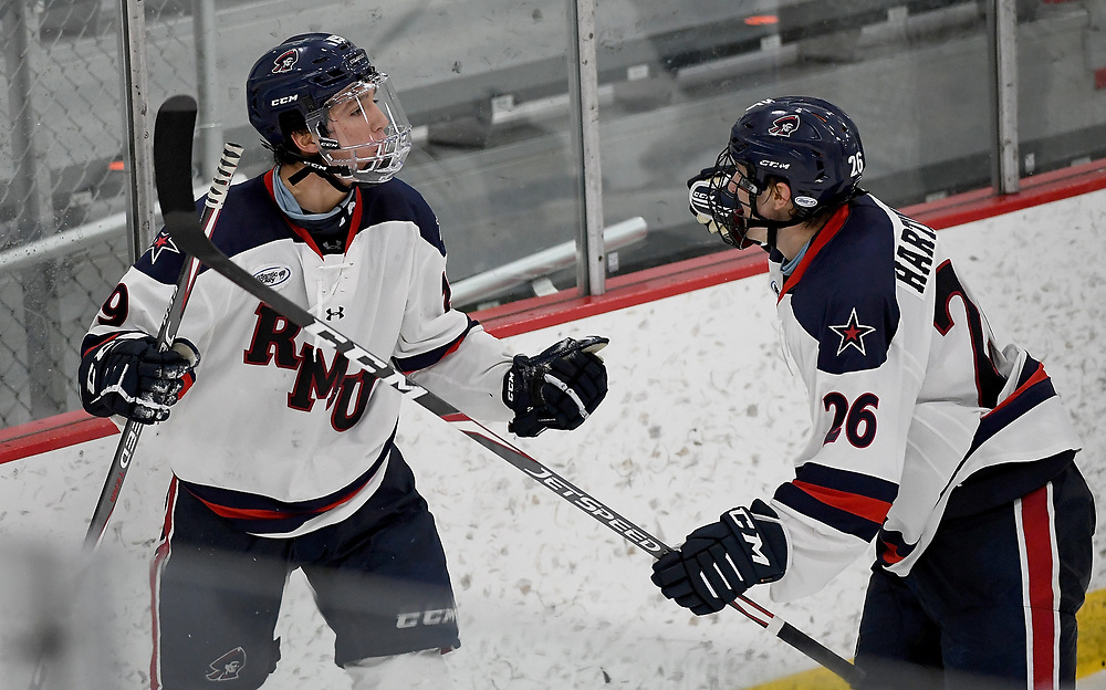 PITTSBURGH, PA - NOVEMBER 22: Randy Hernandez #19 of the Robert Morris Colonials celebrates with Santeri Hartikainen #26 after scoring his first NCAA goal in the third period during the game against the Alabama-Huntsville Chargers at Clearview Arena on November 22, 2020 in Pittsburgh, Pennsylvania. (Photo by Justin Berl/Robert Morris Athletics)