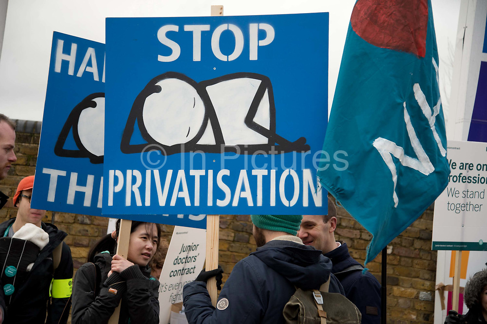 Homerton hospital, Hackney, London. Junior doctors on strike for 24 hours, Tuesday January 12th 2016, over changes to their working hours. Placard by artist Stik based on a mural he did for the hospital.