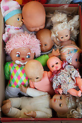 various dolls put together in a box