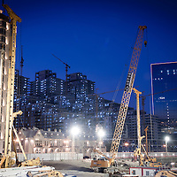 Baku, Azerbaijan, 26 July 2012<br /> Night view of a site where new buildings are under construction.<br /> Baku is the capital and largest city of Azerbaijan, as well as the largest city on the Caspian Sea and of the Caucasus region. It is located on the southern shore of the Absheron Peninsula, which projects into the Caspian Sea. <br /> The city consists of two principal parts: the downtown and the old Inner City (21.5 ha). <br /> Baku's urban population at the beginning of 2009 was estimated at just over two million people. Officially, about 25 percent of all inhabitants of the country live in the metropolitan city area of Baku.<br /> Photo: Ezequiel Scagnetti