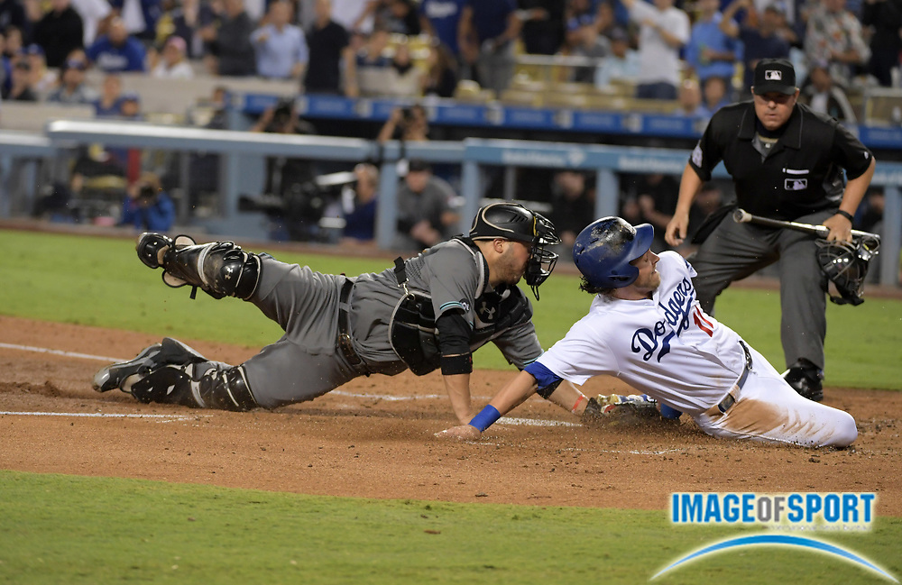 Sep 6, 2016; Los Angeles, CA, USA; Arizona Diamondbacks catcher Welington Castillo (7) tags out Los Angeles Dodgers second baseman Micah Johnson (11) at home plate in the second inning during a MLB game at Dodger Stadium.