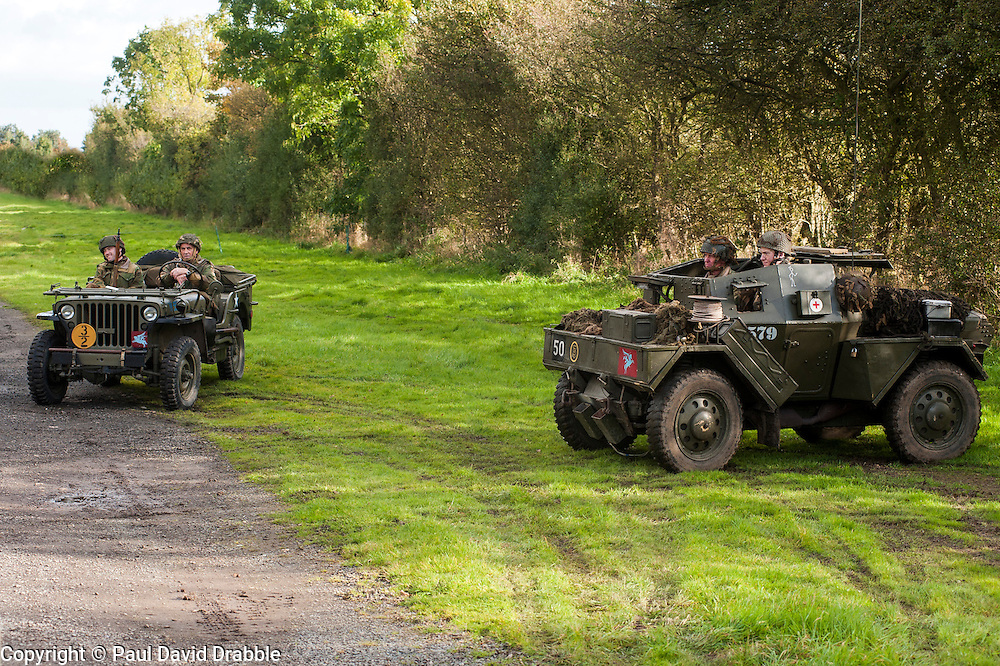 """Reenactors portraying the 6th Airorne Division, in a  Willys Jeep and a Daimler Scout Car """"Dingo"""" at the Pickering Showground Day 2<br /> 14 October 2012<br /> Image © Paul David Drabble"""