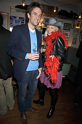 DUNCAN STIRLING and ASTRID HARBORD at a party to celebrate the opening of Barts, Sloane Ave, London on 26th February 2009.
