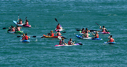 © Licensed to London News Pictures. 03/07/2018. Brighton, UK. Canoeists enjoy the sea as members of the public flock to the beach to enjoy the continued hot weather on the seafront at Brighton on the south coast of England. Photo credit: Ben Cawthra/LNP
