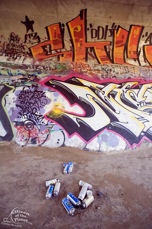 Spray cans and graffiti under a bridge along the LA River in the Sepulveda Basin Wildlife Area. San Fernando Valley, California, USA