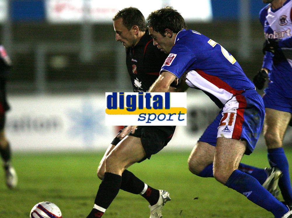 Photo: Paul Greenwood/Sportsbeat Images.<br />Carlisle United v Swindon Town. Coca Cola League 1. 04/12/2007.<br />Swindon's Blair Sturrock, (L) holds off the challenge of Richard Keogh