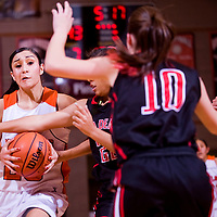 112712       Cable Hoover<br /> <br /> Gallup Bengal Rebecca Herrera (25) drives into the Academy Chragers defense Tuesday at Gallup High School.